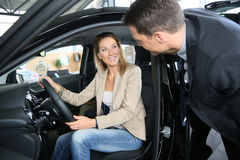 Car salesman with potential buyer in car Royalty Free Stock Photo