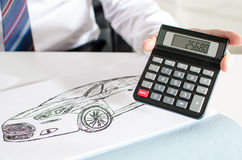 Car salesman showing the price of a car Royalty Free Stock Image