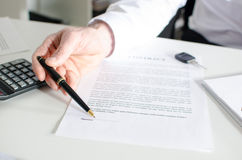 Car salesman showing a sales contract Royalty Free Stock Photos