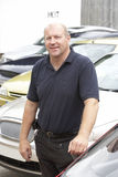 Car salesman standing on lot. Looking relaxed royalty free stock photos