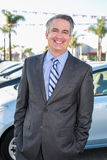 Car salesman. Standing outside a dealership royalty free stock images