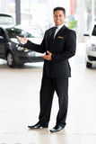 Car salesman welcoming Royalty Free Stock Image