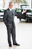 Car salesman welcoming Royalty Free Stock Photo