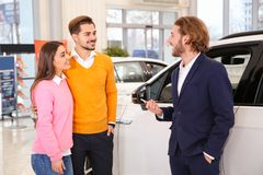 Free Car Salesman Working With Couple Stock Images - 142080694