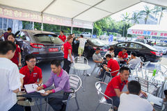Car salespersons talking with prospective Chinese brand automobile buyers at Dongguan car exhibition Royalty Free Stock Images