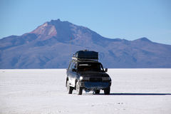 Car and salt desert Stock Image