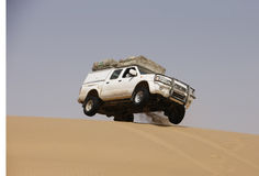 A car on sand dune, Africa Royalty Free Stock Photo