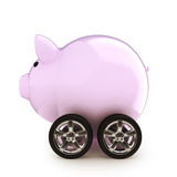 Car savings. Piggy bank with wheels on a white back ground. Money savings on a vehicle concept for buying, renting, insurance, fuel, service and repair costs Stock Photo