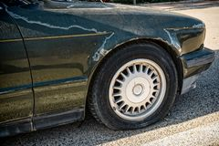 Car in scrap condition. Wasted care with punctured tyres and and open fuel tank royalty free stock photos