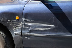 Car with scratches. Blue car with scratches on drivers door Royalty Free Stock Photos