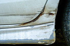 Car scratches dents and holes. Silver color vehicle needs repair stock photos
