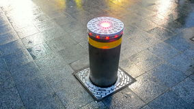 Car security metal pylon on stone reflected surface in Kiev, Ukraine, stock video