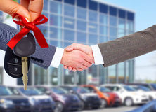 Car seller and client handshake. Stock Image