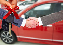 Car seller and client handshake. Royalty Free Stock Images
