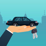 Car seller hand holding key to buyer. Selling, leasing or rentin Royalty Free Stock Image
