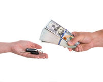 Car selling concept. Female hand holding a car key and handing it over to another person.Man holding dollars Stock Image