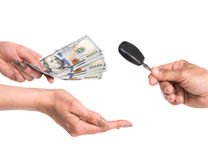 Car selling concept. Male hand holding a car key. Woman holding dollars Royalty Free Stock Photography