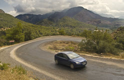 Car on serpentine road in mountains royalty free stock photos