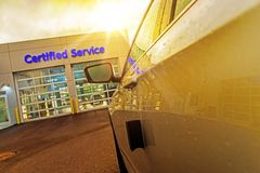 Car Service Auto Care. Center. Car in Front of Two Gates to Authorized Certified Auto Service Stock Photos
