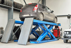Car service #1. Brown car on elevator inside car service waiting for repairs Royalty Free Stock Image