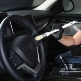 Car service. Cleaning of  interior by a brush 4 Stock Images