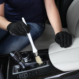 Car service. Cleaning of  interior by a brush Stock Image