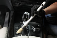 Car service. Cleaning of  interior by a brush Royalty Free Stock Photo