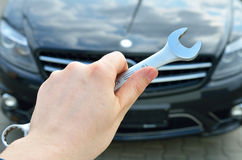 Car service concept. Hand holding a screw key Royalty Free Stock Image