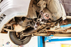 Car in service. Detail of the wheel assembly on automobile Royalty Free Stock Photography