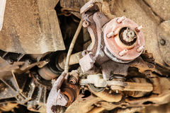 Car in service. Detail of the wheel assembly on automobile Royalty Free Stock Image