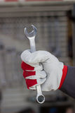 Car service. Hand holding wrench. Car service. Hand holding wrench in car repair service Royalty Free Stock Photo