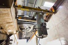 Car on service platform in garage. Stock Photos