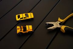 Car service - pliers and two toy cars stock photos
