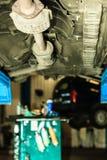 Car in service repairing. Auto repair shop. Stock Photos
