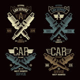 Car service spark-plug emblems. In retro style. Graphic design for t-shirt. Color print on a black background Royalty Free Stock Photos