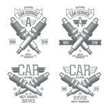 Car service spark-plug emblems. In retro style. Graphic design for t-shirt. Dark print on white background Stock Photo