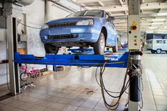 Car service station on the lift. Stock Image