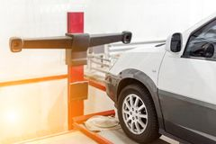 Car at service station. Wheel laser alingment equipment. Vehicle maintenance and check up concept stock image