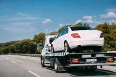 Car Service Transportation Concept. Tow Truck Transporting Car Or Help On Road Transports Wrecker Broken Car. Auto