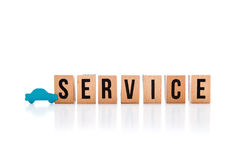 Car Service - wooden block letters on white reflective backgroun Royalty Free Stock Images