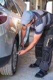 Car service worker diagnoses car breakdown stock image