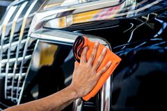 Free Car Service Worker Polishing Car With Microfiber Cloth. Stock Image - 183999881