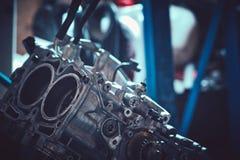 Car servicing, old piston at engine block. Closeup Royalty Free Stock Image