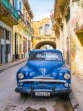 Car in a shabby street in Havana Stock Photo
