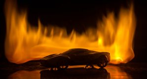 The car in the shadows with glowing lights in low light, or silhouette of sport car dark background stock photography