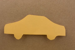 Car shape cut out of yellow paper Royalty Free Stock Image