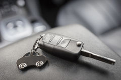 Car shape keyring and remote control key Royalty Free Stock Images