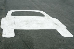 Car Shaped White Sign on Asphalt Stock Image
