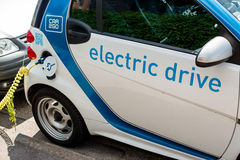A car-sharing electric Smart is being recharged Royalty Free Stock Photos
