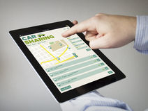 Car sharing web on a tablet royalty free stock photography